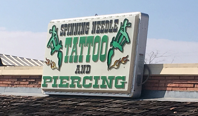 Spinning Needle Tattoo